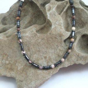 nice leopard skin jasper necklace  on rock