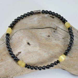 yellow ople anklet on wood,jpg